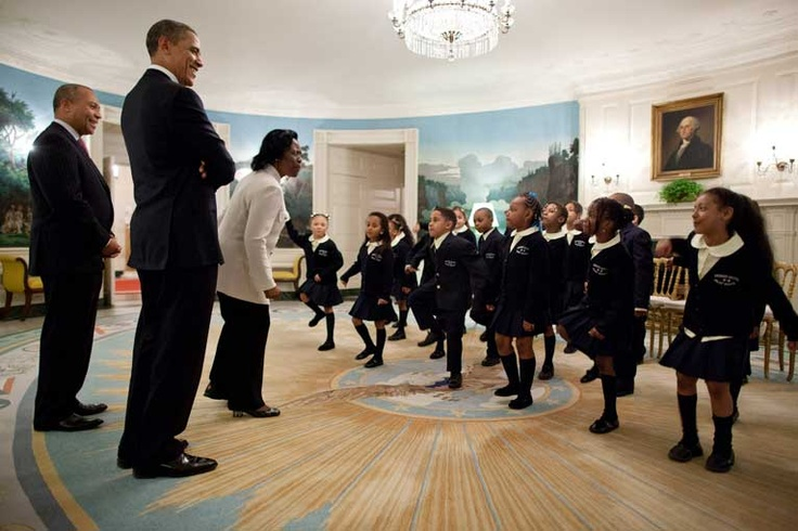 Obama and Massachusetts Governor Deval Patrick listen as students from Orchard Gardens K-8 School in Roxbury, Mass., perform Dr. Martin Luther King Jr.'s 'I Have a Dream' speech in the Diplomatic Reception Room of the White House.
