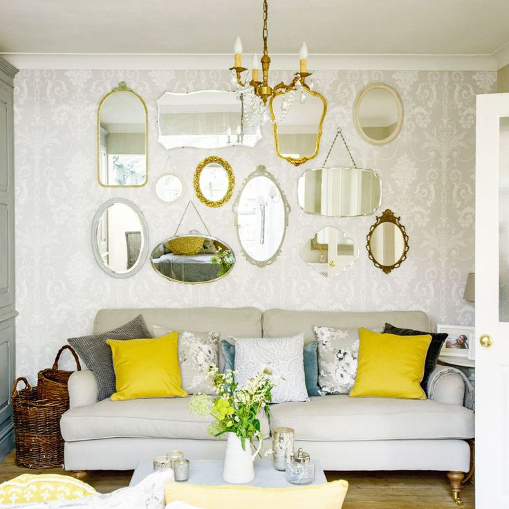 Love retro living rooms? Take a look at this fabulous space with feature mirror wall and hits of sunny yellow for inspiration