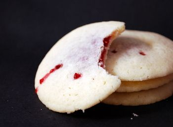 Vampire cookies! 3/4 cup butter, softened  1/2 cup sugar  1 large egg  1/2 tsp vanilla extract  1/8 tsp almond extract  1 1/2 cups all purpose flour  1/4 tsp salt  approx 1/2 cup red jam (raspberry/strawberry)