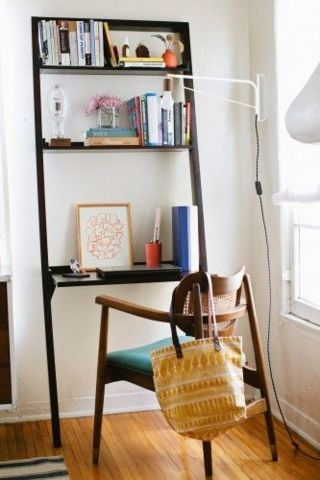 a leaning desk is a great space-saver. | domino.com