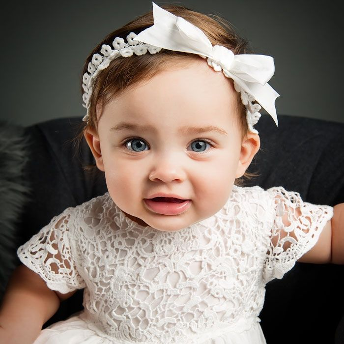 The Grace Headband is an elegant accessory for baby girls from our Grace collection. Baby Beau and Belle specializes in layette gowns and designer baby outfits & clothing.