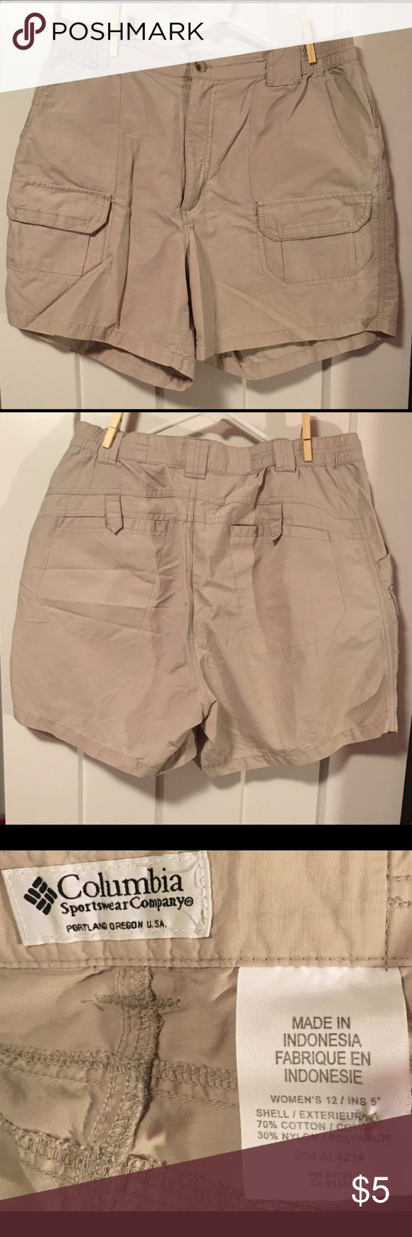 Women's Columbia Fishing Shorts Tan Size 12 Women's tan Columbia fishing shorts.  Size 12 and have a small spot on the front; otherwise in great condition.  Blend of cotton and nylon, so super comfy.  Cute enough for casual, party, career or fun use. Columbia Shorts