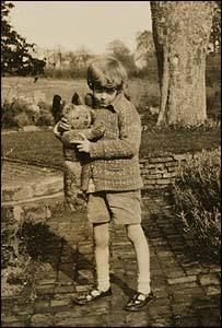 Christopher Robin with his Edward Bear or Winnie-the -Pooh. Milne wrote the Pooh stories, not as children's literature but for the inner child within all adults.