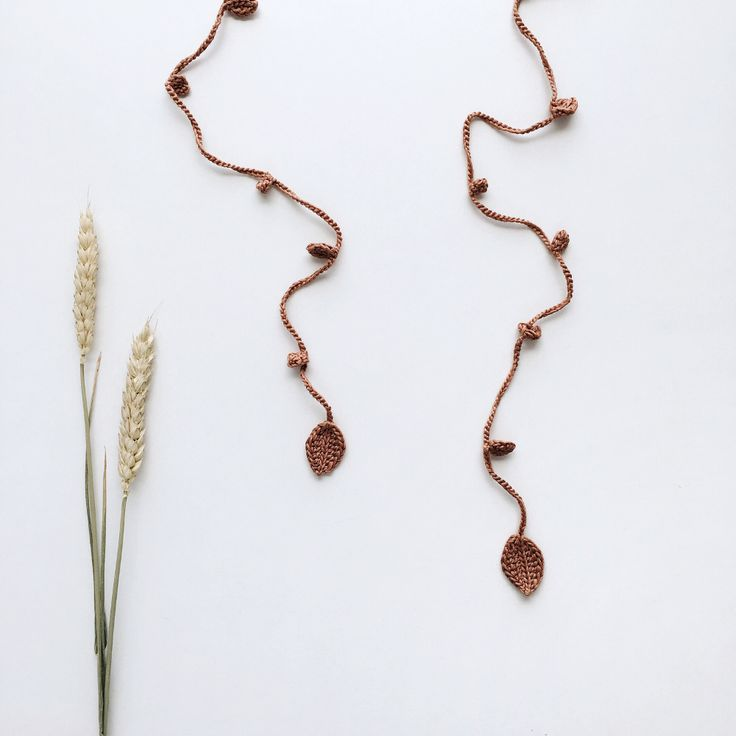 Gold color necklace with tiny crochet leaves of various sizes #handmadejewelry