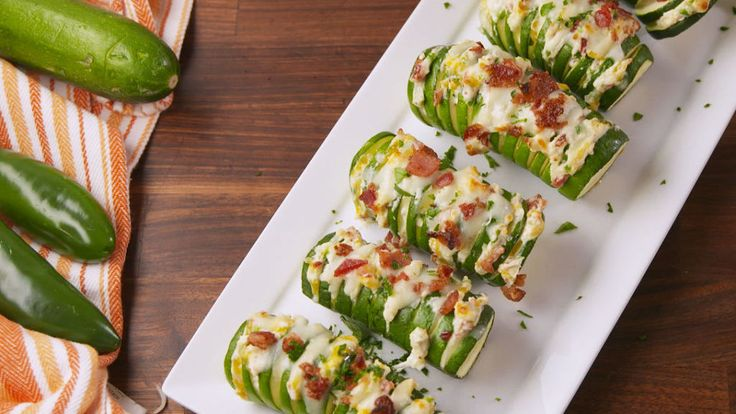 Next time slice zucchini at popper filling point, dollop of filling on each and bake with the extra cheese/bacon!