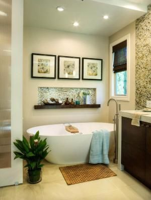 This transitional bathroom has a recessed nook for a free-standing tub. A built-in alcove with a mosaic tile backsplash adds visual interest to the wall while also keeping bath time essentials handy. Overhead, recessed lighting keeps the space bright and open. Shelf above tub, love it! by Natasia