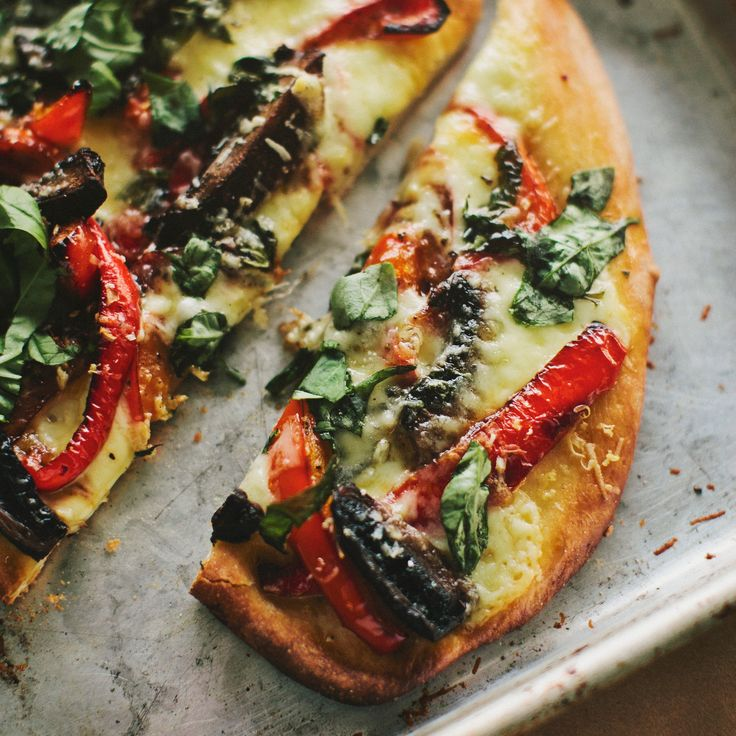 This delicious homemade pizza is topped with meaty portobello mushrooms, creamy mozzarella cheese, sweet red peppers and fresh basil. It serves two to four people.