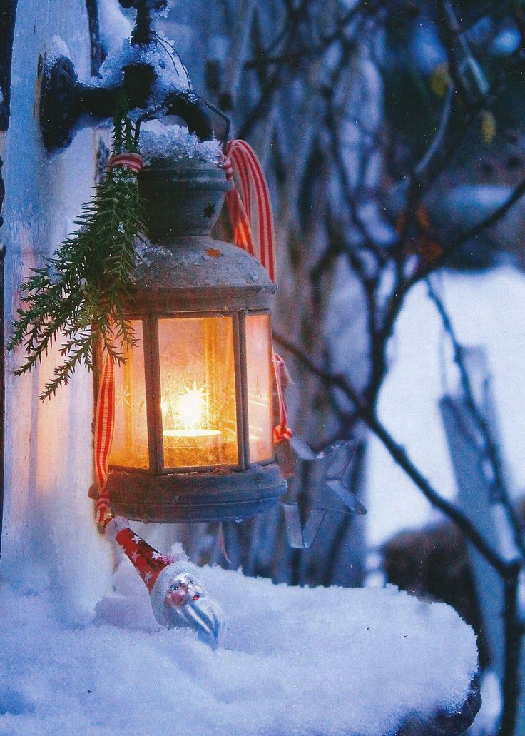 Decorate outdoor lights with greens and ribbon