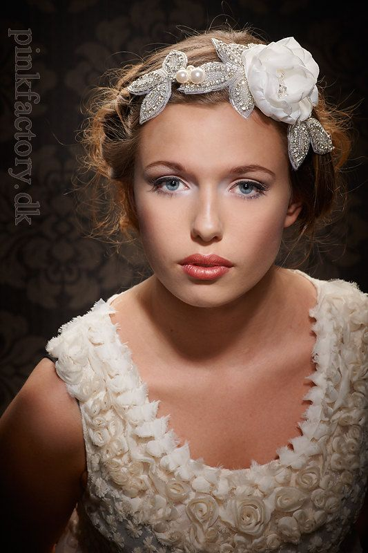 Utterly romantic hair piece with flower and rhinestones. The photo is out of this World