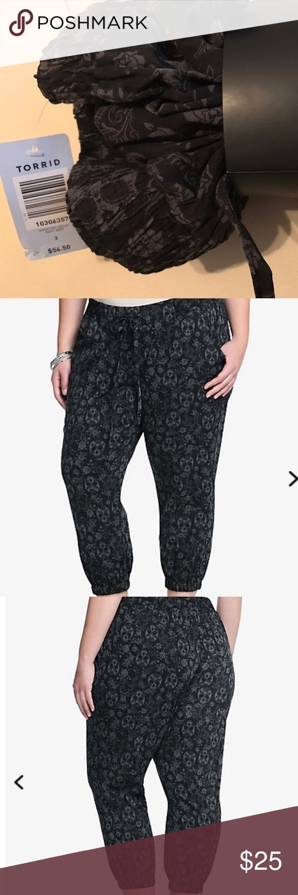 NWT Torrid Harem Pants with Skulls Size 3 Torrid brand Harem pants with Skulls design. Size 3, bought and they are too large, lost original receipt and could not return. Paid $58, will sacrifice price to sell. We are a pet friendly home. Smoke free home torrid Pants Ankle & Cropped