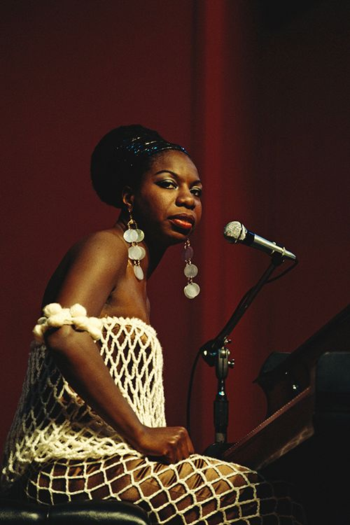 Nina Simone, 1965. Born Eunice Kathleen Waymon (1933-2003), Simone was an American singer, songwriter, pianist, arranger, and civil rights activist widely associated with jazz music. Her musical style arose from a fusion of gospel and pop songs with classical music, accompanied with her expressive jazz-like singing in her characteristic low tenor.