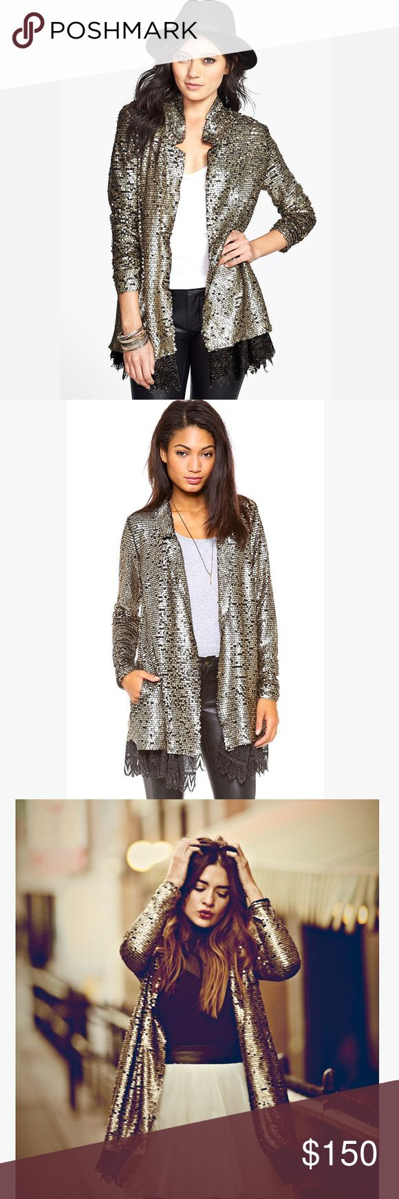 Free people gold sequin lace trim blazer jacket GORGEOUS perfect condition Blazer or jacket covered in tarnished or rusted looking gold sequins, and lined with a black lace trim along the bottom. Tags are no longer attached but it's brand new and never worn Free People Jackets & Coats Blazers