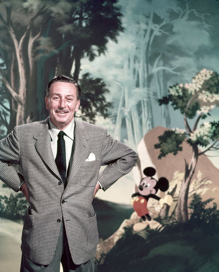 Walt Disney poses before a scene with his signature creation, Mickey Mouse, circa 1955. 23 Magical Pictures From The Golden Years Of Disney