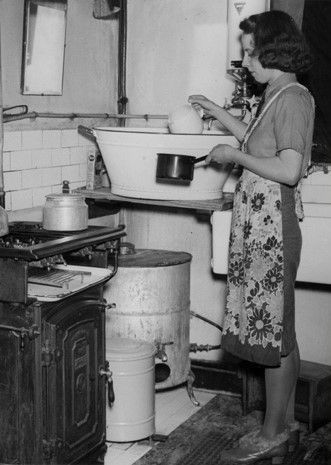 WWII - A British woman saving water while she does the washing