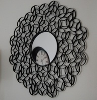 Creative mirror/artwork using toilet paper rolls!