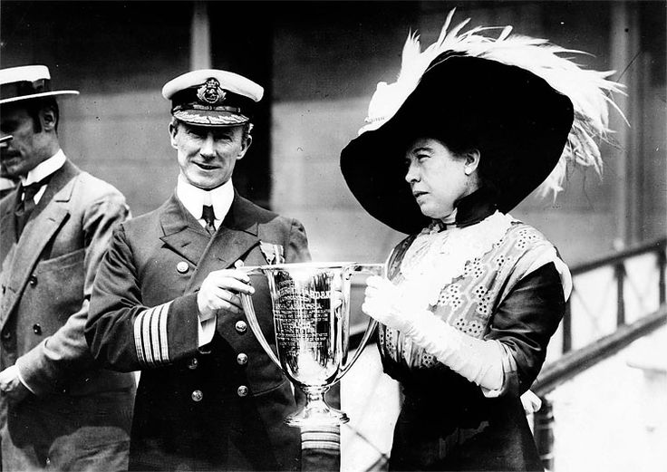"""The 100th Anniversary of the Sinking of Titanic: Captain Arthur Henry Rostron is presented with an award by Margaret Brown, a survivor of the RMS Titanic sinking who later came to be known as """"The Unsinkable Molly Brown,"""" in this undated photo. Rostron was honored for his efforts as commander of the RMS Carpathia, which rescued many of the Titanic survivors from the north Atlantic Ocean and ferried them to safety in New York. (The New York Times)"""