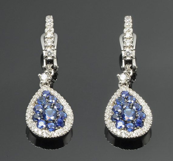 Earrings in 18 kt gold with #sapphires of 1,75 ct and natural brilliant-cut white #diamonds of 0,55 ct. The #earrings are available in white gold, rose gold, yellow gold but you can also customize carats, quality, and color of #gemstones. All our #jewelry are made in italy. Contact us for any particular request.