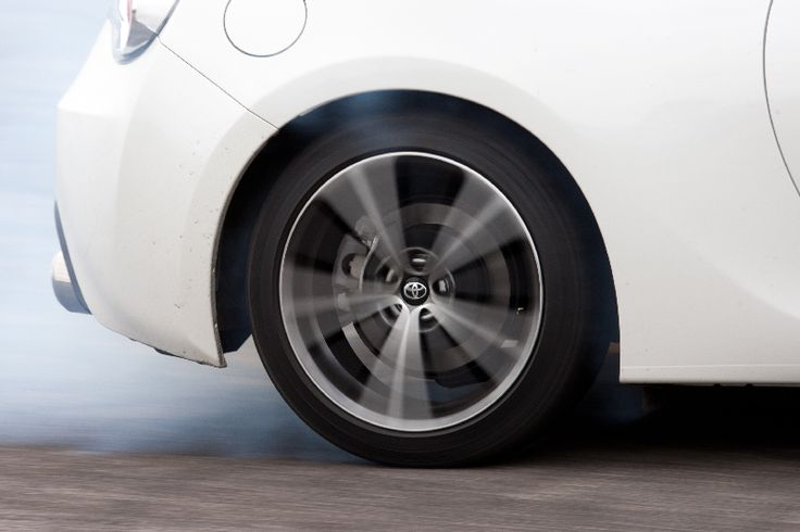 A white GT86 burning rubber