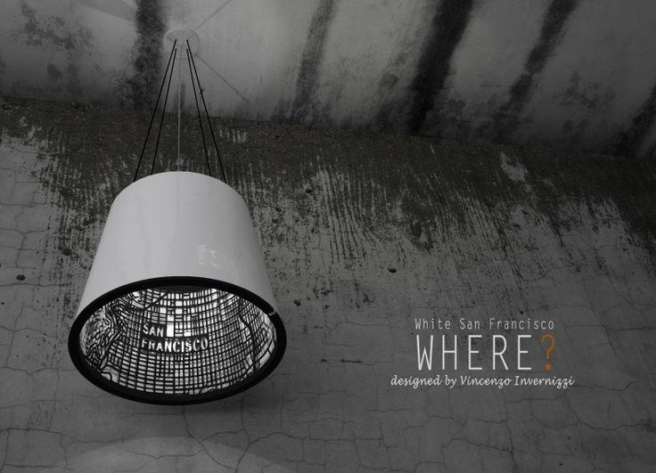 WHERE..? E' una lampada a sospensione dall'apparente semplicità ma con un'anima nascosta. All'interno del paralume, in ceramica bianca o in terracotta, si cela una struttura metallica intagliata sugli schemi urbanistici di alcune famose città.