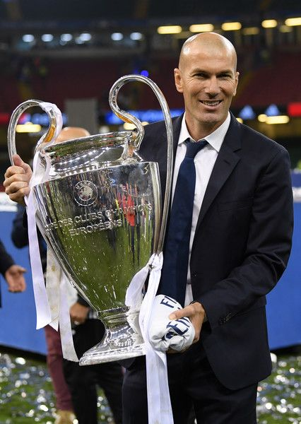 Zinedine Zidane, Manager of Real Madrid poses with the trophy after the UEFA Champions League Final between Juventus and Real Madrid at National Stadium of Wales on June 3, 2017 in Cardiff, Wales.