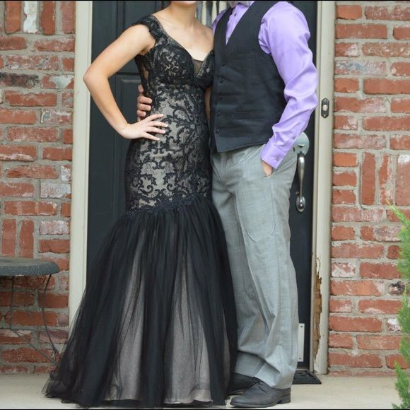 """Sherri Hill Gorgeous Black Mermaid Dress The epitome of class! This beautifully made dress is size 2 and was tailored to fit a 5'1"""" lady with a 4"""" heel. It is sophisticated and hugs all curves. It has beaded detail that is sewn into the lace-like design. Worn once. Perfect condition minus a small tear on the inside of the dress and is not visible and can be easily fixed if desired. In a few pics I added extra material in the front. THE NUDE MATERIAL WAS ROMOVED. Ask any questions. :) Sherri…"""