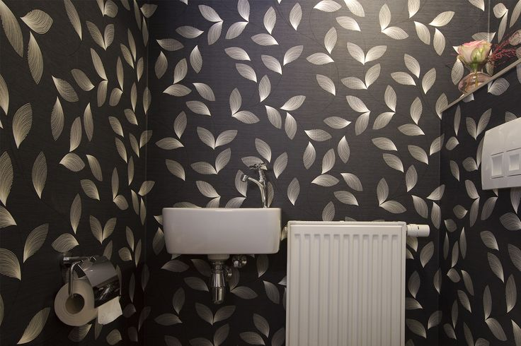 Toilet with feather wallpaper