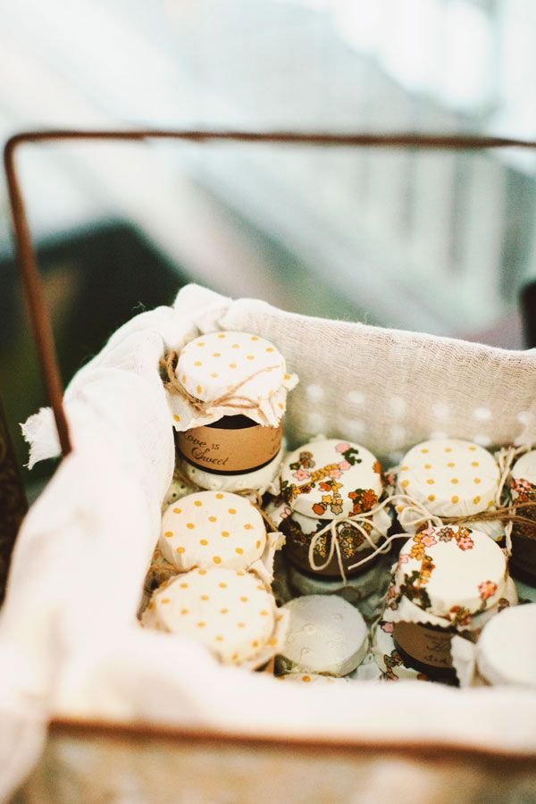 Little jars of honey topped with pretty scraps of fabric make a sweet favor.