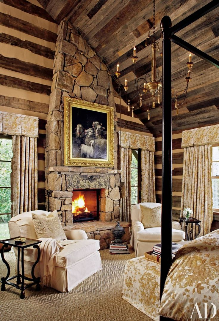 Bedroom stone fireplace - Cozy Yet Glamorous Log Cabin Bedroom With Stone Fireplace Four Poster Bed And Chandelier I Really Like The Idea Of A Fireplace In The Bedroom