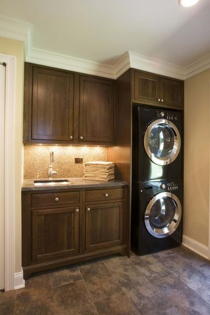 Single-wall savvy in New York. A stacked washer and dryer can save space, as seen in this simple laundry room. Houzzers liked how the laundry area took up only one tiny wall — an idea that can easily work in smaller home