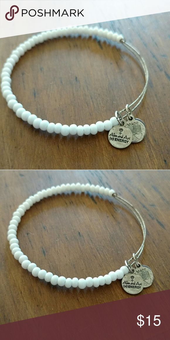 Alex & Ani white beaded bracelet Alex & Ani white beaded bracelet. Silver wire is a little tarnished, but has only been worn a handful of times. No box. If you're interested, please consider making an offer! Alex & Ani Jewelry Bracelets