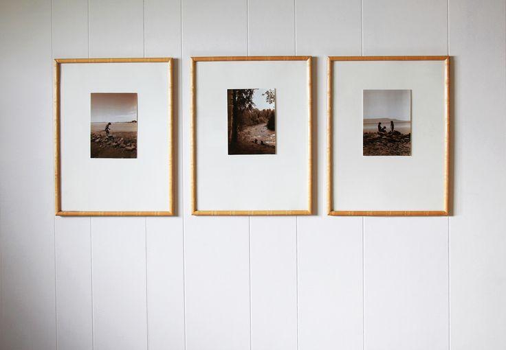 set of three sepia photos framed with white matting