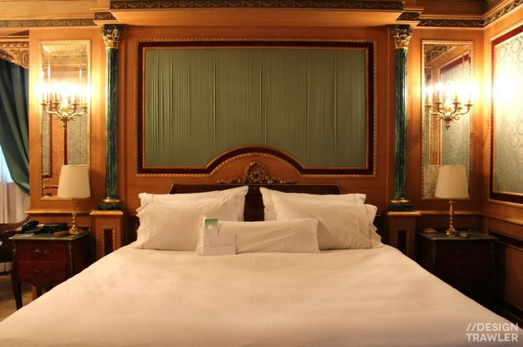 Westin Palace, Milan: Master bed with wall and table lamps, pleated silk and marble