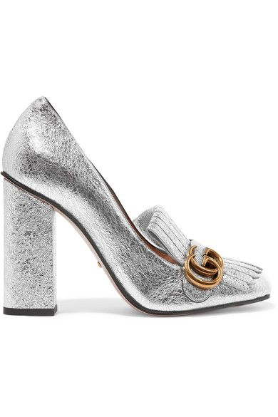 First spotted on the Resort '16 runway, Gucci's fringed pumps have since become a cult favorite. This block-heeled pair has been crafted in Italy from silver cracked-leather that glitters with each step and are topped at the square toe with the house's iconic 'GG' motif. Wear yours with everything from evening dresses to distressed denim.