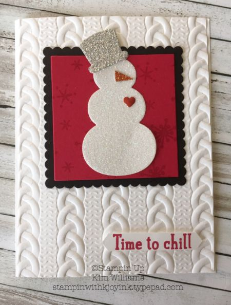Stampin Up Snow Place Snowman card. Kim Williams, Stampin with Kjoyink. Pink Pineapple Paper Crafts. The Cable Knit emboss folder gives this card a warm and cozy feel. I love snowmen especially when they sparkle like this one. Snow Friends framelit dies were used on the snowman as well as beautiful glimmer paper for this winter christmas card.