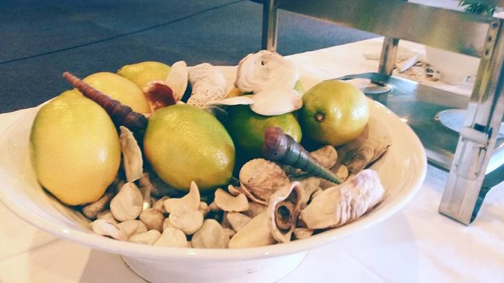 Bowl with lemons and sea shells at our nautical themed christening.