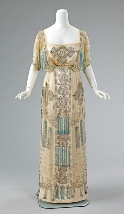 Edwardian. I like that the mannequin looks as if she's trying not to frighten a bear or similar massive predator.