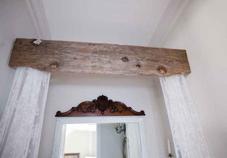 Use barnwood to make a rustic valance for the bath tub.