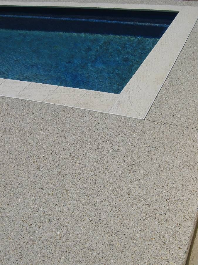 Tan concrete aggregate with fine bright stone maxi mix. Paini Concrete - Perth WA.