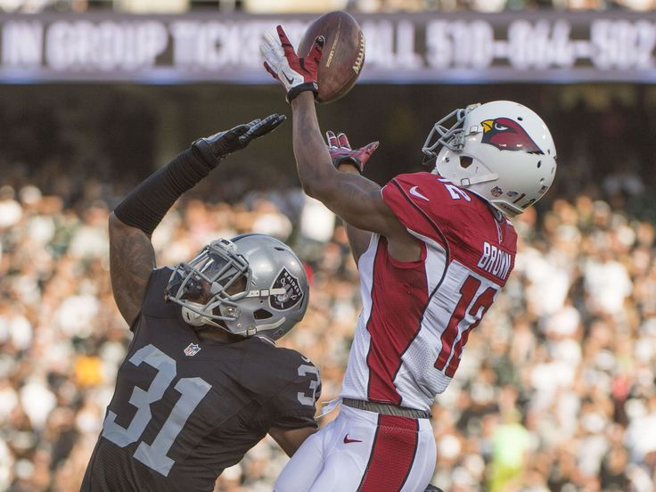 Arizona Cardinals wide receiver John Brown, right, makes a catch against Oakland Raiders defensive back Neiko Thorpe during the second quarter in a preseason NFL football game at O.co Coliseum.  Kyle Terada, USA TODAY Sports