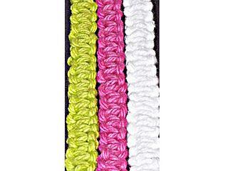 Yarn bracelets.  Just like making hemp necklaces so long ago...