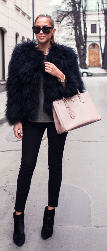 Kenza Zouiten is wearing a Pello Bello fur jacket, Jennie-Ellen boots and a Prada handbag