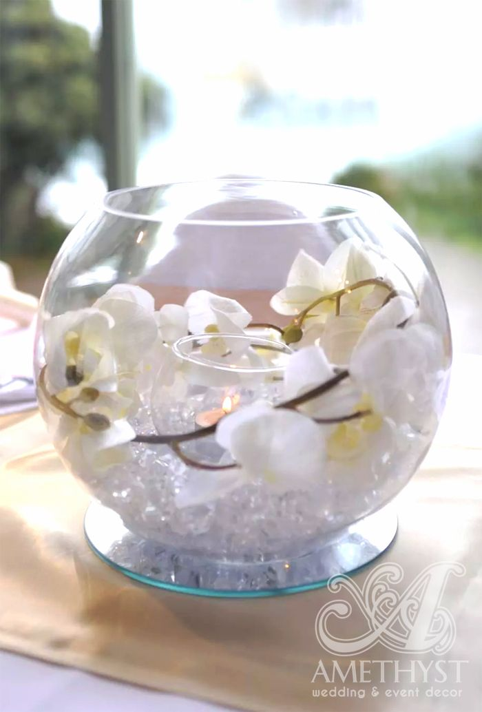 Beautiful wedding fishbowl centerpiece with white orchids