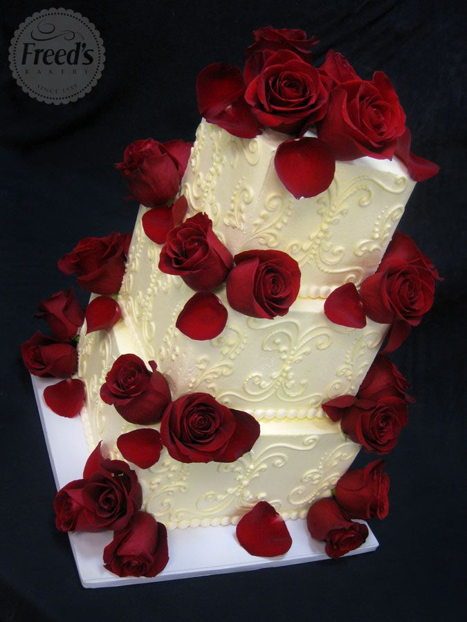 I'm thinking working in rose petals is a good way to subtly bring in Beauty and the Beast without it being cheesy. Also, they're stunning in silk as well, although petals alone may not bother anyone's allergies. Classic Wedding Cakes | Freed's Bakery Las Vegas |