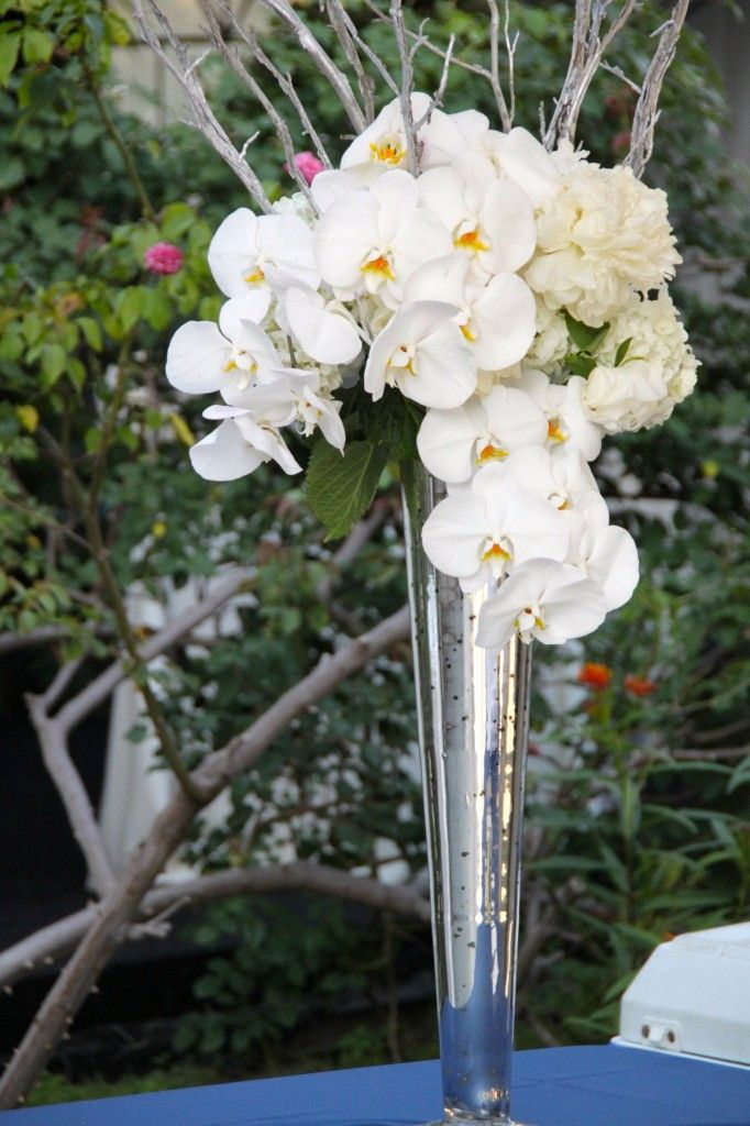A Tall Arrangement In Silver Conical Mercury Glass Vase Using White Phalaenopsis Orchids