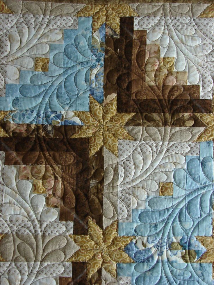 Log cabin stars, feather wreath quilting by Quilt Vine