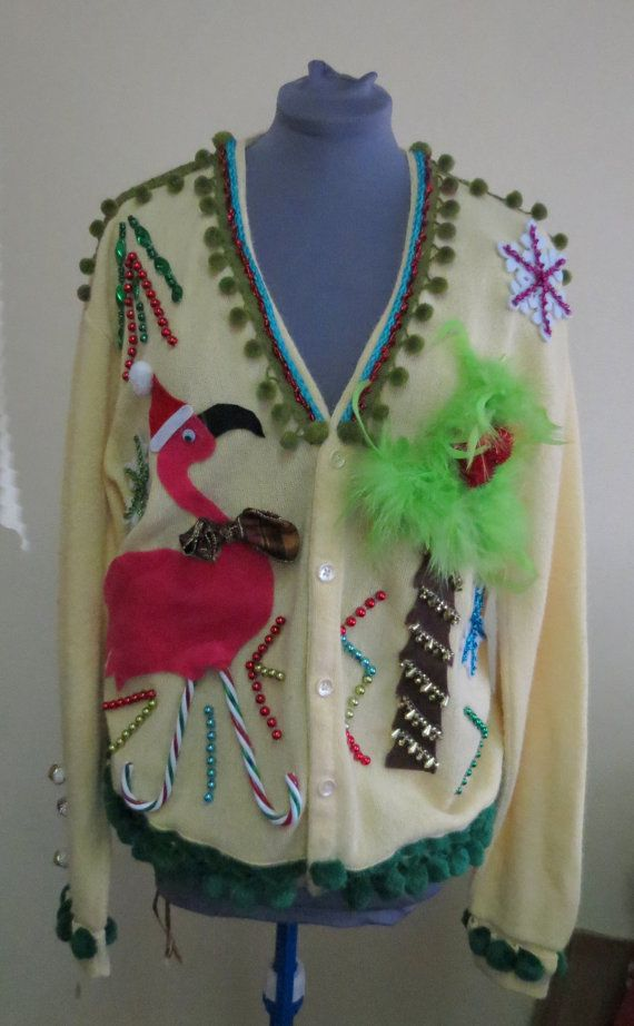 3-D Pink Flamingo Tacky Ugly Christmas Tropical Delight and total Fun Cardigan Golf Sweater Size  XL, our design was voted in 2013 by Huffington Post one of the top 47 ugly christmas sweaters for the year!  made by uglychristmassweaters.com and available on ebay and etsy.  Each sweater is hand decorated, and design is property of Black Dog Sign Shop