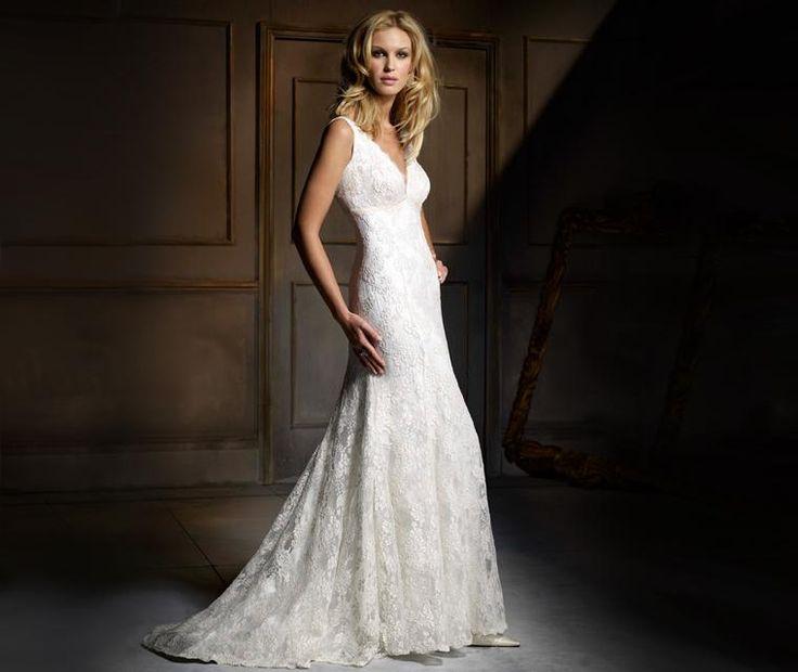 Shangri-La  Soft V neck ivory and mocha corded lace wedding dress with soft panelled fishtail skirt and ivory taffeta ribbon under bust trim.