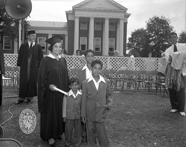 University of Maryland School of Law graduate Juanita Jackson Mitchell in cap and gown with her sons Clarence M. Mitchell III, Keiffer Mitchell, and Michael Bowen Mitchell.