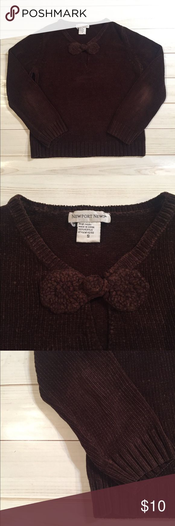 Dark Brown Bow Sweater A warm, cozy, and thick sweater in a dark brown collar. Features a cute bow across the neckline.  Worn a decent amount of times, as noted by the lighter elbow color. perfect for the inevitable winter. Newport News Sweaters