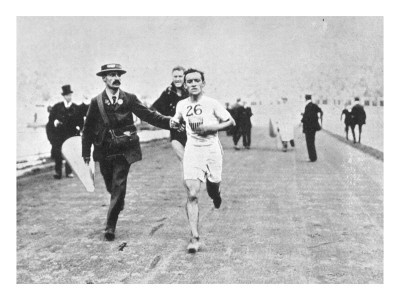 Johnny Hayes of the  USA nears the finish line to win the 1908 Olympic Marathon Gold Medal~ London.  Hayes actually finished 2nd, but was declared the winner after Dorando Pietri of Italy, the first finisher,  was disqualified for illegal assistance across the finish line.